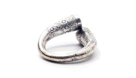 Old silver ring on a white background.