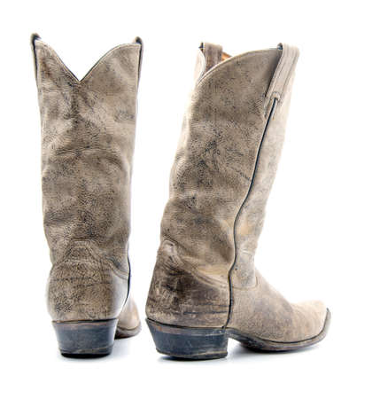 Brown cowboy boots isolated on a white background. Stock Photo