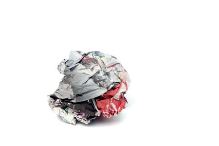 Crushed Newspaper ball isolated on white background. Banque d'images