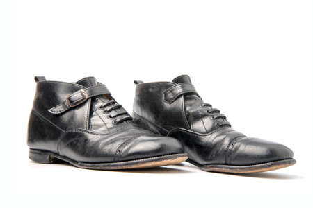 Pair of Used Businessman shoes isolated on a white background.