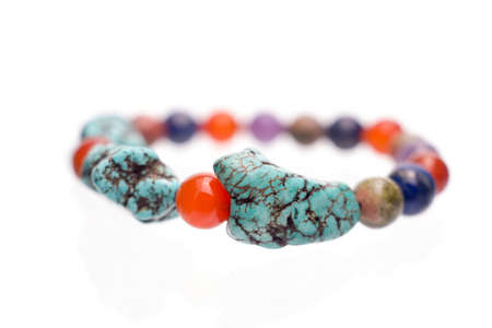 Turquoise, Unakite, lapis lazuli, Carnelian and Amethyst  bracelet isolated on white background.