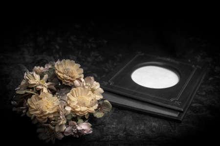 Flowers haggard with photo book , still life Banco de Imagens
