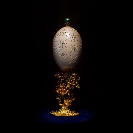carved ostrich egg shell on black background.