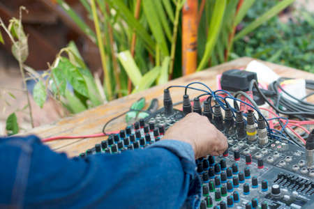 Hands of male and sound mixer