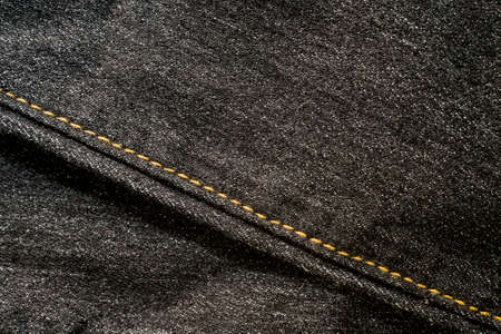Close up of  blue denim jeans fabric texture background. Banco de Imagens