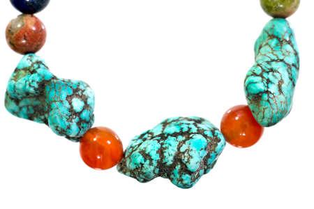 Turquoise, Unakite, lapis lazuli, Carnelian and Amethyst  bracelet isolated on white background.