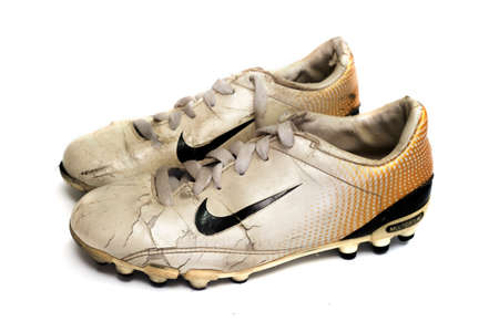Chainat Province, Thailand, June 21, 2019. illustrative editorial Old Nike brand football shoes, isolated on a white background. 新聞圖片