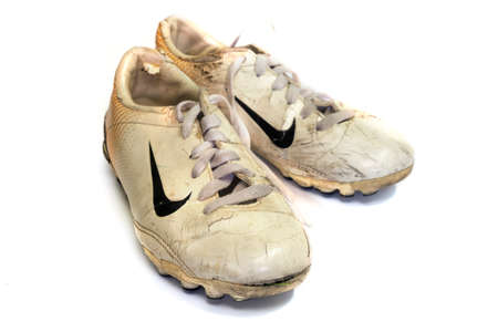 Chainat, Thailand - June 21, 2019: editorial image of Old Nike brand football shoes, isolated on a white background.