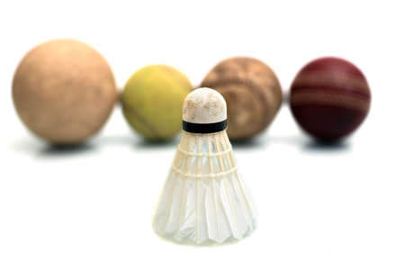 badminton and various types of balls on a white background
