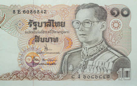 Chainat Province, Thailand, 3 July 2019. illustrative editorial,Ten baht banknotes of Thailand. The portrait of King Rama IX in the uniform of the Supreme Commander. Issue Date September 20, 1980 Redakční