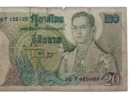 Chainat Province, Thailand - 3 July 201 : Twenty baht banknotes of Thailand. The portrait of King Rama IX in full regalia. Issue Date June 9, 1971​