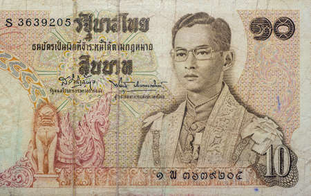 Chainat Province, Thailand - 3 July 2019 : Ten baht banknotes of Thailand. The portrait of King Rama IX in full regalia. Issue Date June 24, 1969​