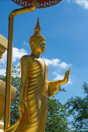 Buddha statue, Buddha walking at Pagoda temple in Thailand. 版權商用圖片