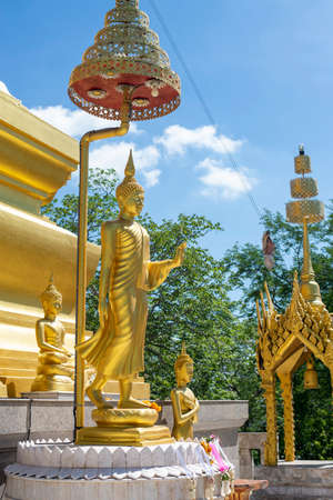 Buddha statue, Buddha walking posture at Pagoda temple in Thailand. Stock Photo