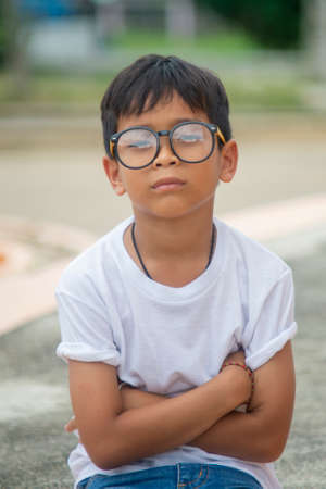 Asian boy wearing a white T-shirt with glasses Stock Photo