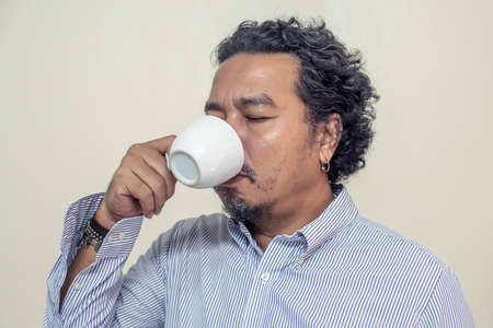 Man drinking coffee in a mug