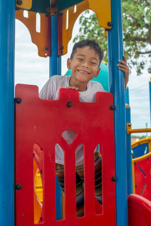 Portrait of cute Asia boy smiling happily playing on the color playground Reklamní fotografie - 128178730