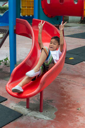 Portrait of cute Asia boy smiling happily playing on the color playground Reklamní fotografie - 128178760