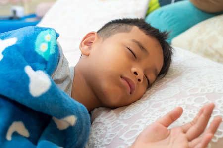 Little boy sleeping in bed at home. sweet dream Reklamní fotografie - 128178866
