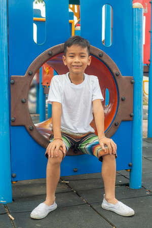 Portrait of cute Asia boy smiling happily playing on the color playground Reklamní fotografie - 128178882