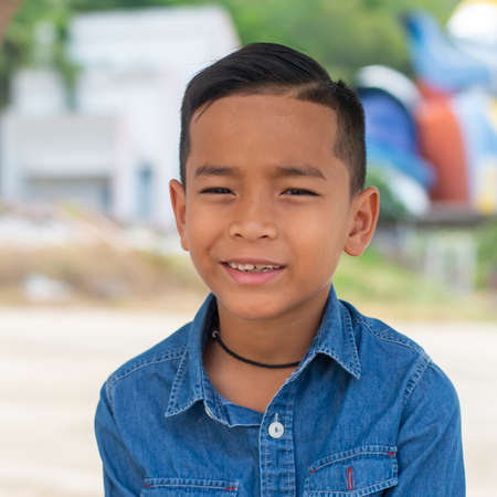 Asian boy smiling happy looking at the camera