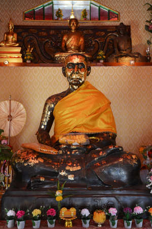 The statue of Phra Thammachot, the monk in the Ayutthaya period, leading the struggle of villagers