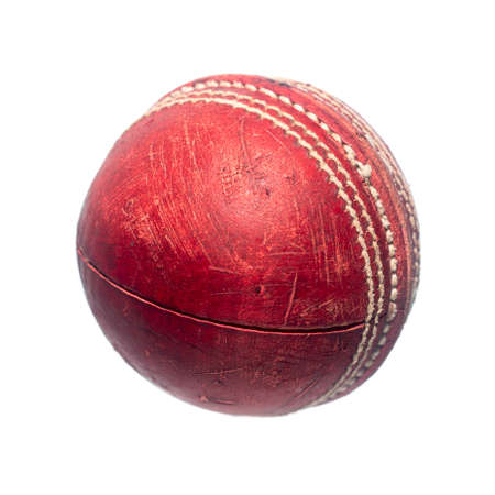 Old red leather cricket ball isolated against a white background Banque d'images