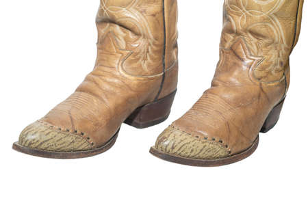 Brown cowboy boots isolated on a white background. 版權商用圖片
