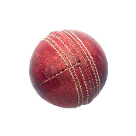 Old red leather cricket ball isolated against a white background Stock Photo