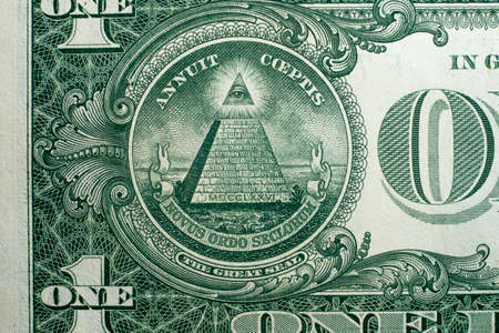 Annuit coeptis motto and the Eye of Providence on the reverse side of American one dollar bill.