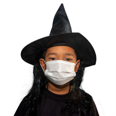 The boys with mask wearing witch hat halloween. Stock Photo