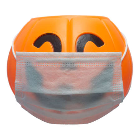 Halloween pumpkin wearing a mask to prevent coronavirus (COVID 19)