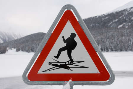 phisical: Sign post alerting against the possibility of ice breaking Stock Photo