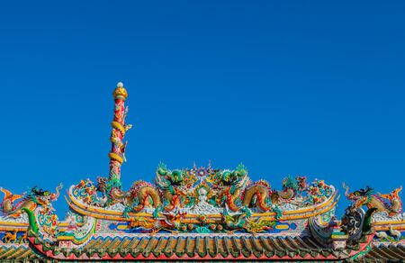 dragon on the roof of chinese temple photo