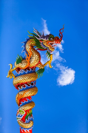 dragon on blue sky background Stock Photo