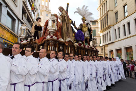 Malaga, Spain - April 17, 2011 - Bearers of religious images during processions in Holy Week