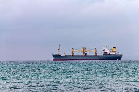 Cargo ship leaving port Stock Photo