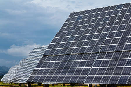 Large solar panels with a cloudy sky photo