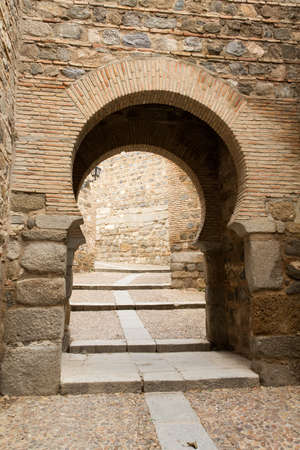 Gate into the old town of Toledo, Spain