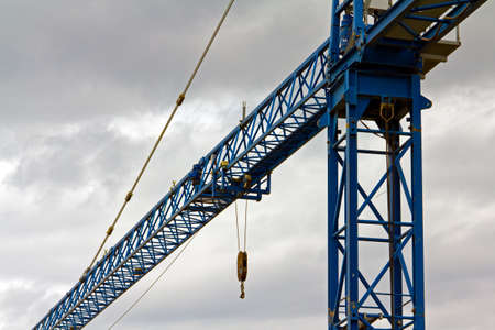 cloud industry: Tower crane arm against a cloudy sky