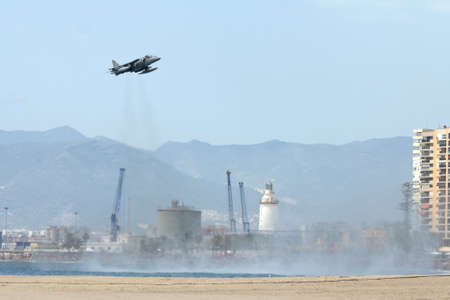Malaga, Spain - May 28, 2011: Harrier II Plus jet standing over Malagueta beach in the Spanish Army Day. Editorial