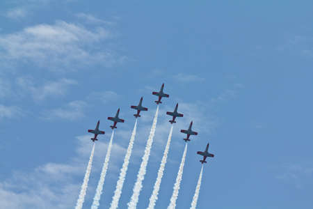 Airplanes in tight formation on an air show