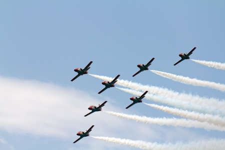 A team of seven airplanes on an air show