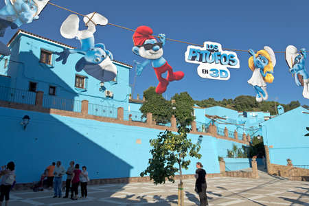Juzcar, Malaga (Spain) - June 16, 2011: Church square decorated with smurfs signs
