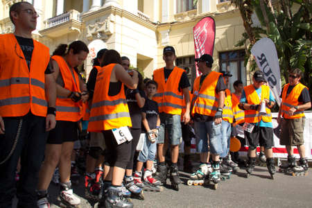 MALAGA, SPAIN - JUNE 19: Volunteer skaters of the organization wait at the start line of the 6th Skate Day race on June 19, 2011 in Malaga, Spain Editorial