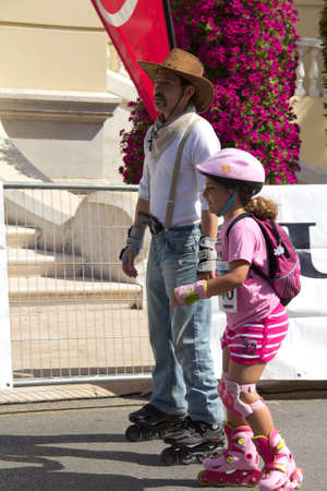 MALAGA, SPAIN - JUNE 19: Father disguised as cowboy skates with her daughter at the 6th Skate Day race on June 19, 2011 in Malaga, Spain