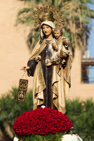 Religious image of the Virgin during the Virgen del Carmen festival Stock Photo
