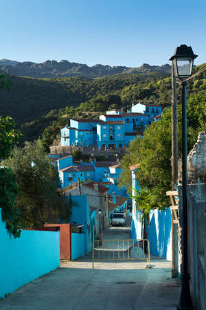 JUZCAR, SPAIN - CIRCA JUNE 2011: Alley of the village painted blue circa June 2011 in Malaga, Spain. The village was painted blue after Sony chose it for the world premiere of the new movie