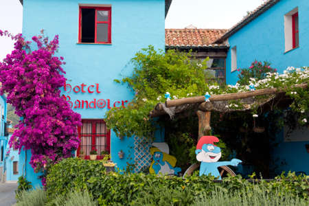 JUZCAR, SPAIN - CIRCA JUNE 2011: Hotel decorated with Smurfs pictures circa June 2011 in Malaga, Spain. The village was painted blue after Sony chose it for the world premiere of the new movie