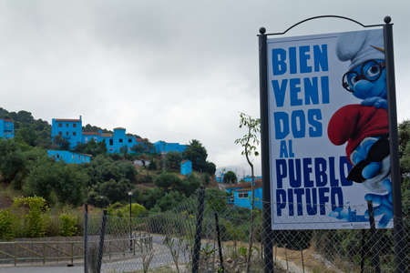 JUZCAR, SPAIN - CIRCA JUNE 2011: Smurfs sign welcomes people at the entrance of the village circa June 2011 in Malaga, Spain. The village was painted blue after Sony chose it for the world premiere of the new movie